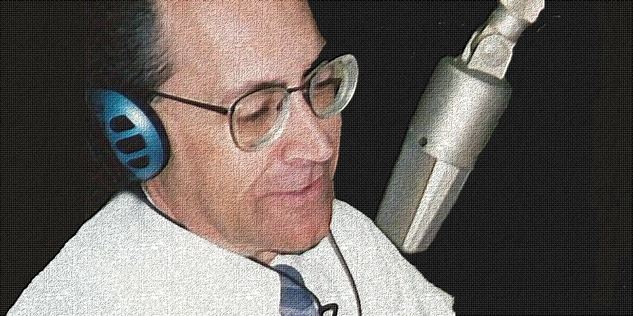 gary-morgan_sitting-at-microphone_bigger_old-canvass_900x450