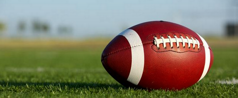 football_laying-on-field_800x330