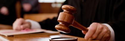courts_judge-hand-holds-gavel_900x450